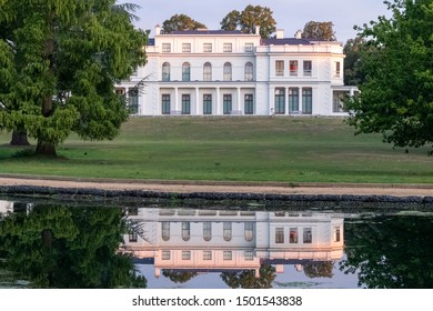 London UK, September 2019. Newly renovated mansion at Gunnersbury Park and Museum on the Gunnersbury Estate. Photographed in the early mornng with the building reflected in a lake in the park.