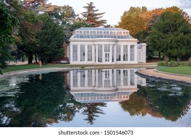 London UK, September 2019. Newly renovated Orangery at Gunnersbury Park and Museum on the Gunnersbury Estate. Photographed in the early mornng with the building reflected in a lake in the park.