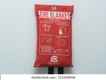 London, UK, September 23, 2019: Fire blanket mounted in the wall in the house. Fire safety alert.