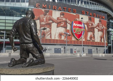 LONDON, UK - SEPTEMBER 24, 2014 : Thierry Henry bronze statue outside the south Clock End of the Emirates Stadium, North London, home of English Premier League team Arsenal Football Club.