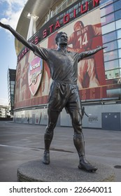 LONDON, UK - SEPTEMBER 24, 2014 : Tony Adams bronze statue outside the North Bank End of the Emirates Stadium, North London, home of English Premier League team Arsenal Football Club.