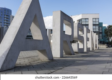 """LONDON, UK - SEPTEMBER 24, 2014 : Giant concrete letters spelling """"Arsenal"""" on the entrance to the Emirates Stadium, North London, home of English Premier League team Arsenal Football Club."""