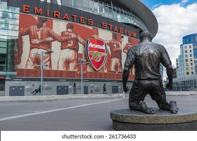 LONDON, UK - SEPTEMBER 24, 2014 : Arsenal Football Club Emirates Stadium in North London, England with club legend and all time record goal scorer Thierry Henry bronze statue.