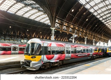 LONDON, UK - SEPTEMBER 26, 2014: The Heathrow Express train with Vodafone commercials promoting high speed internet is waiting at the beautiful Paddington Station on September 26, 2014 in London, UK.