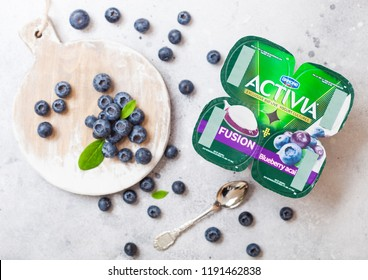 LONDON, UK - SEPTEMBER 26, 2018: Activia yogurt with blueberries by Danone with berries