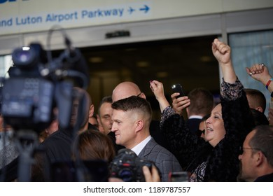 London, U.K. - September 27, 2018: Tommy Robinson  smiles to supporters as he leaves to get a train back to Luton, following his hearing at the Old Bailey.