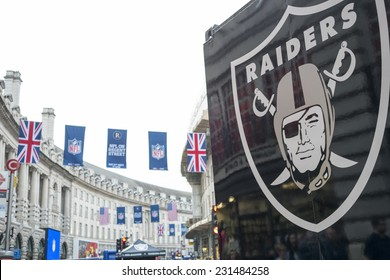 LONDON, UK - SEPTEMBER 27: Detail of Oklahoma Raiders banner and NFL flags above in Regent Street. September 27, 2014 in London. The street was closed to traffic to host NFL related games and events.