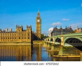 LONDON, UK - SEPTEMBER 28, 2015: Tourists on Westminster Bridge at the Houses of Parliament aka Westminster Palace (HDR)