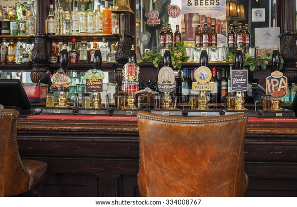 LONDON, UK - SEPTEMBER 28, 2015: Draught cask beers in a traditional English Pub