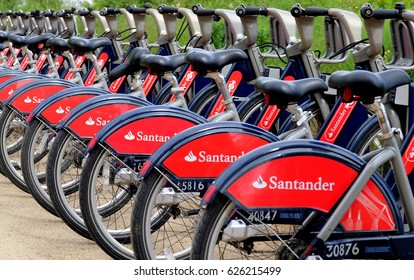 LONDON, UK - SEPTEMBER 3, 2016: Row of Santander sponsored red public hire bicycles at  docking station in the City of  London also known as Boris Bikes after former Mayor of London, Boris Johnson