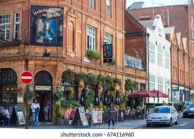 London, UK - September 8, 2016: People having a rest in the Public house in Mayfair