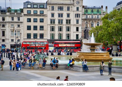 LONDON, UK - SEPTEMBER 8, 2018: Fountain on Trafalgar Square. Vacationers residents and tourists. Buses double decker on the road