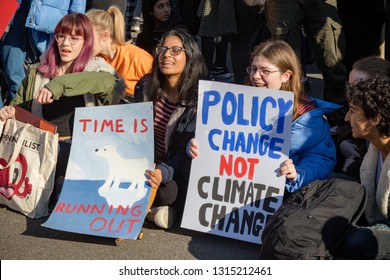 London, UK, United Kingdom 15th February 2019:- Striking school aged children in central London over climate change stage a sit down protest blocking Parliament Square