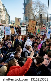 London, UK, United Kingdom 15th February 2019:- Striking school aged children in central London over climate change stage a sit down protest blocking roads around Parliament Square