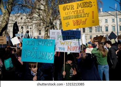 London, UK, United Kingdom 15th February 2019:- Striking school aged children in central London over climate change holding placards