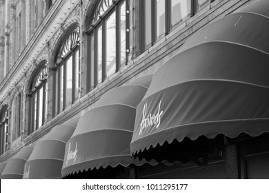 LONDON, UK, UNITED KINGDOM - JULY, 2016: HARRODS detail of the entrance of the historical department store in central London. Harrods sign on the outside.