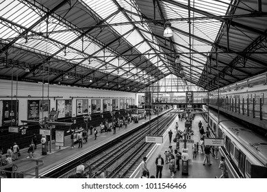 LONDON, UK, UNITED KINGDOM - JULY, 2016: Inside Earl´s Court station in Kensington platform with train passing and underground sign in London, UK. London Underground is the busiest metro system world.