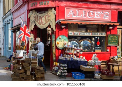 LONDON, UK, UNITED KINGDOM - JULY, 2016: Alice's shop of Portobello Road with tourists and pedestrians with interesting store, Alice's on corner of Denbigh road. The road is famous for its market.