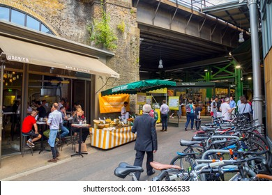 LONDON, UK, UNITED KINGDOM - JULY, 2016: Borough Market with people and bikes parked in Central London. Borough Market is a wholesale and retail food market, one of the largest and oldest in London.