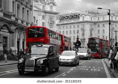 LONDON ,UK: View of street on AUGUST 30, 2014 in London. Red busies and taxi is popular kind of transports in London,Double-decker buses with black and white background