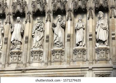 London, UK - Westminster Abbey facade detail. Modern Martyrs set of sculptures depicting Martin Luther King Jr, St Oscar Romero, Dietrich Bonhoeffer, Esther John and Lucian Tapiedi.