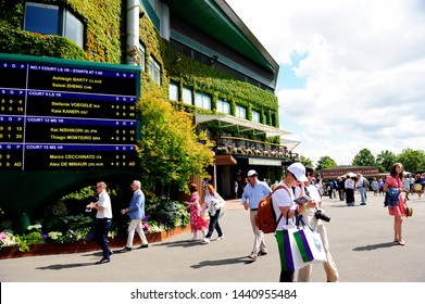 LONDON, UK-2 JULY 2019: People in front of center court in The 2019 Wimbledon Championships. It is a Grand Slam tennis tournament that is currently taking place at the All England Lawn Tennis club.