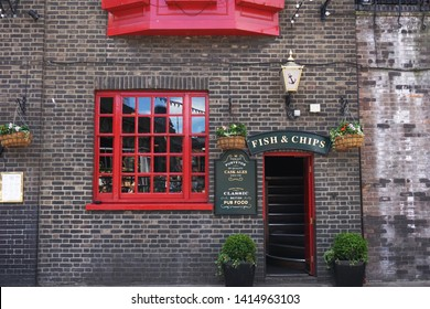 LONDON, UK-2 JUNE 2019: Green sign of Fish & chips over the door of The Anchor Bankside pub situated on one of the most historical reaches of the Thames close to Southwark Cathedral and London Bridge