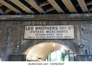 LONDON, UK-2 JUNE 2019: Old sign above an entrance to Borough Market,  Lee Brothers Potato Merchants, Borough Market, potato merchants established 1875, located on Southwark and Borough High street UK