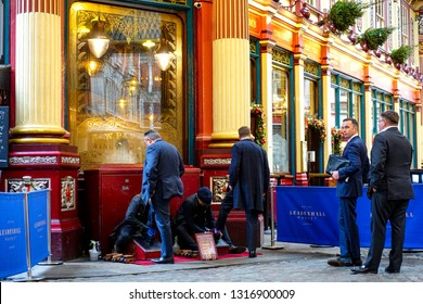 London, UK-2017/11 shoeshine boy doing their efforts to clean local white-collar workers' leather shoes in London.