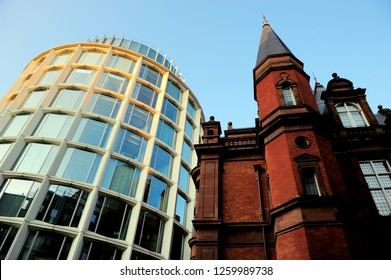 LONDON, UK-22 JULY 2013: Old style brick building and modern round glass building in Buckingham Gate, Victoria Street, SW1, City of Westminster, London, United Kingdom