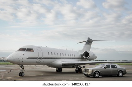 London, UK-7 MAY, 2019: Private executive airplane with limousine Rolls Royce Phantom luxury car shown together at international Heathrow Airport. VIP service at the airport. Business class transfer.