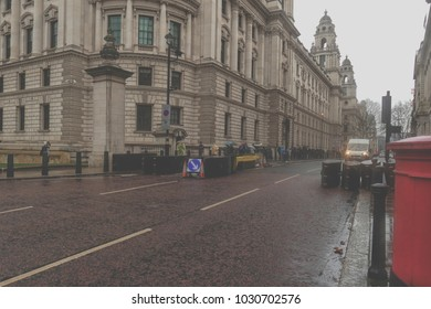 LONDON, UK-FEBRUARY 10, 2018:Commuters and tourists struggling through the rain in London