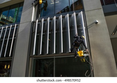 LONDON, UK-February 18: Window cleaners work on the new buildings in Kings Cross. The redevelopment of Kings cross is the largest area of redevelopment in Europe. February 18, 2016 in London UK