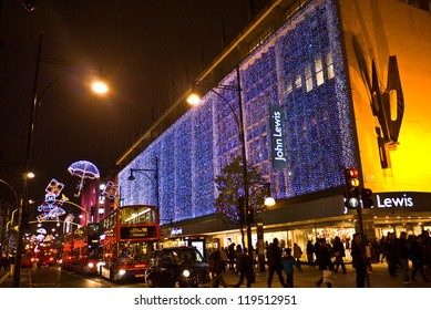 LONDON, UK-NOVEMBER 16: Shoppers are encouraged to London's West End to do their shopping, by the Christmas lights and department store's decorations along Oxford Street.November 16, 2012 in London UK