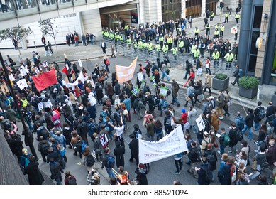 LONDON, UK-NOVEMBER 9: Student demonstrators carrying banners protest against fee increases, march past police manning barriers to stop them from entering the Stock Exchange on November 9, 2011 in London UK