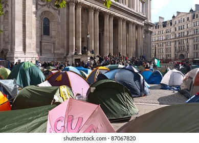 LONDON, UK-OCTOBER 19:  Occupy London anti capitalist camp of tents and protesters mix with the tourists  and city workers around the entrance to St Paul's Cathedral. October 19, 2011 in London UK.