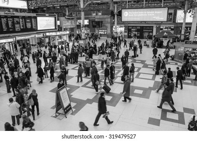 LONDON UNDERGROUND - OCTOBER 22, 2007: View of people walking inside a subway station in London at rush hour. Subway began operation in January, 10th of 1863