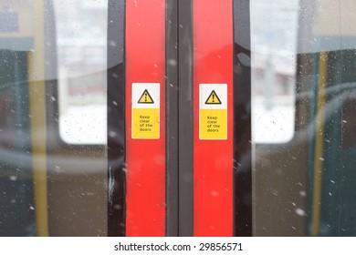 London underground tube train doors with snow flakes.