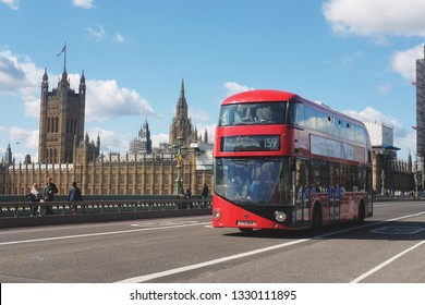 London, United Kindrom - 09.07.2018: Red bus on the bridge in London.