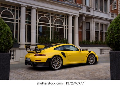 London, United Kingdom - 01/01/2019: A sporty-looking yellow Porsche 911 (991) GT2RS, in front of The Connaught luxury hotel. It is the latest and most powerful road car ever manufactured by Porsche.