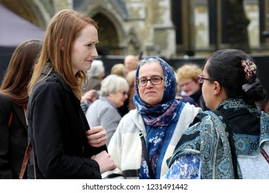 London / United Kingdom - 04.24.2018: Members of diverse public unveiling of  statue of suffragette Millicent Fawcett , Parliament Square