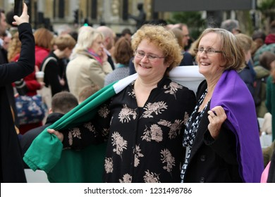 London / United Kingdom - 04.24.2018: women wearing the suffrage flag at the unveiling of the statue of suffragette Millicent Fawcett at the Parliament Square