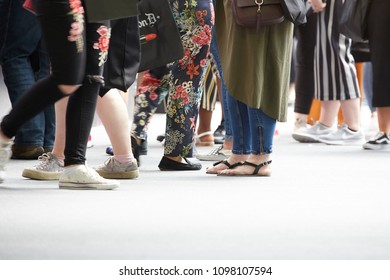 London / United Kingdom - 05 19 2018: Make-Up Artist Show - IMATS, running and standing feet and legs of cosmetics enthusiasts, OLYMPIC NATIONAL CENTRAL LONDON exhibition hall