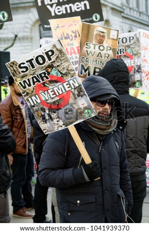 London, United Kingdom, 07th March 2018:- Protesters gather outside Downing Street in central London to voice opposition to the visit of the Saudi Crown Prince Mohammad bin Salman to the UK