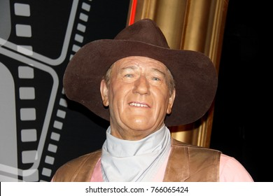 London, - United Kingdom, 08, July 2014. Madame Tussauds in London.  Waxwork statue of John Wayne. Created by Madam Tussauds in 1884, Madam Tussauds is a waxwork museum and tourist attraction.