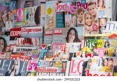 LONDON, UNITED KINGDOM- 1 APRIL 2015: Newsstand found in central London displaying many international titles such as Psychologies Magazine, InStyle, Vogue, Marie Claire and Harperâ??s Bazaar Magazine.