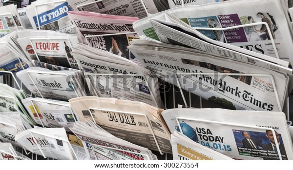 LONDON, UNITED KINGDOM- 1 APRIL 2015: A newspaper rack holding several international newspapers, such as The International New York Times, USA Today, Irish Times, Londra Sera and Corriere Della Sera.