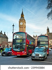 LONDON, UNITED KINGDOM - 11 DECEMBER, 2014: Typical view on London, United Kingdom with the red bus and the taxi or cab in London on 11 December, 2014.