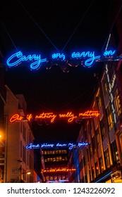London / United Kingdom - 11.23.2018: Carnaby Street Christmas lights with lyrics of Bohemian Rhapsody by Queen, Freddie Mercury