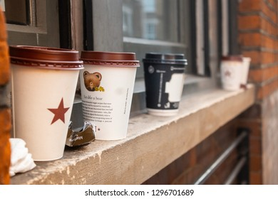 London / United Kingdom - 1.20.2019: Empty single use coffee cups on a window ledge